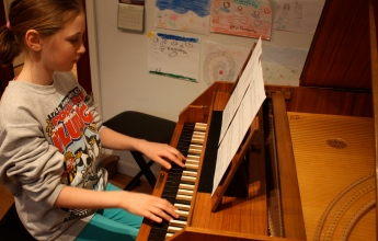 Annabelle practices 3 pieces for the Baroque Concert on Mar 10.