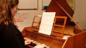 Megan practices her Baroque pieces.