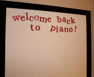 "The marker board is ready for new art and says, ""Welcome back""!"