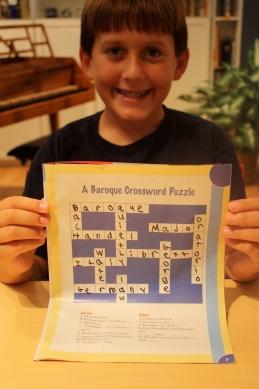 Addison completes his crossword for 3 bonus beads!