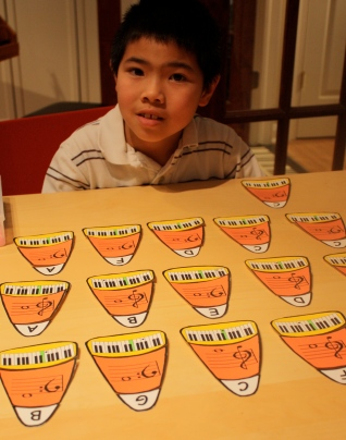 In no time at all, he had mastered the Candy Corn Flashcard game! Great job, Quintin!