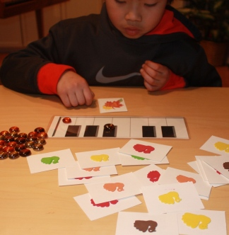 Quintin reviews piano letters and accidentals with Thanksgiving Turkey cards.
