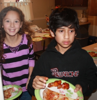Molly and Joseph enjoyed their pizza and wings.
