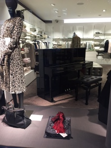 Here's a regular piano in a clothing store. I guess someone plays to attract customers.